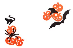Silhouettes of black volatile bat, hat, cat, spider and orange pumpkins, carved out of black paper are isolated on white