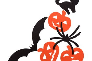 Silhouettes of orange pumpkins black cat, bat and spider carved out of black paper are isolated on white