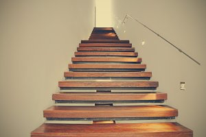 light at the end of the wooden stairs