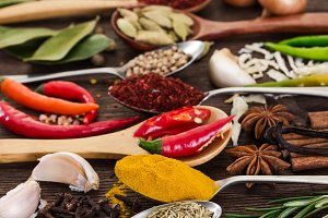 Different fragrant spices in spoons