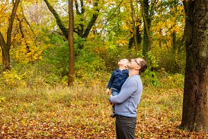 Dad and son in the autumn park