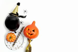 Halloween party decoration on a white background. Flat lay