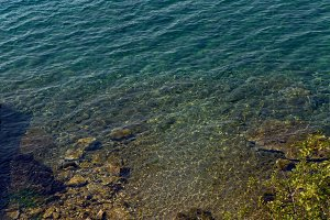 sea with a stone bottom and a blue clear water
