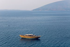 abandoned wooden boat anchored in the Bay