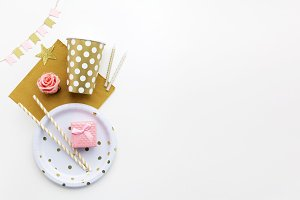 Party background with golden decoration and free space for text. Flat lay. Top view