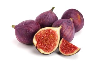 fig fruits with half isolated on white background