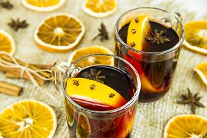 hot alcoholic Christmas drink made of wine and spices with orange - red mulled wine