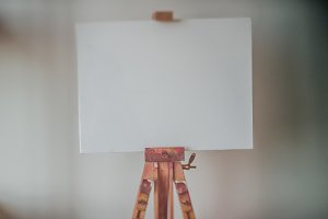 easel, paints, background