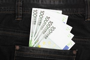 one hundred euro banknotes in a jeans pocket close-up