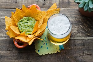 Nachos with guacamole and beer.