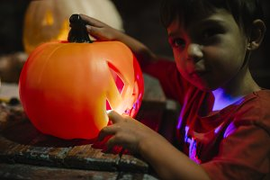 Child with pumpkin