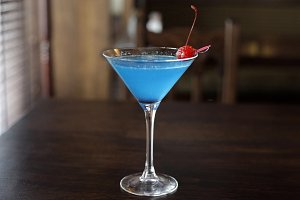 A blue lagoon cocktail in a triangle glass
