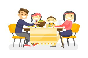 Happy multiethnic family dining at the table.
