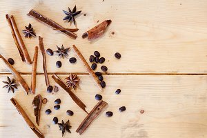 close-up still-life coffee star anise cinnamon christmas holiday on background wooden boards studio