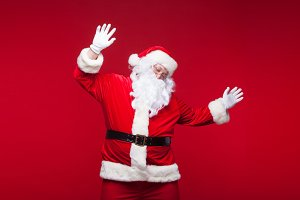 Santa Claus is dancing Isolated on red background.