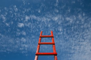 Red wooden staircase against the blue sky