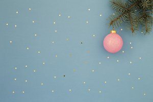 Pink Christmas ball on spruce