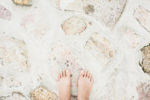 Barefoot on the cement stone floor