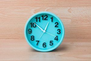 The time clock on wood background