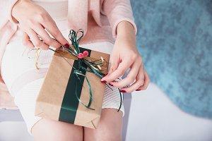 Stylish woman with gift box