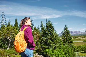 young woman hiker hiking in beautiful mountains