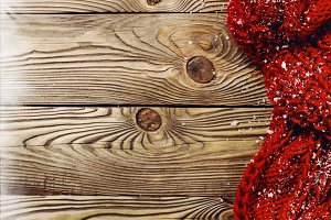 Red scarf on wooden background