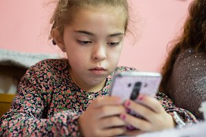 Little girl using an smartphone
