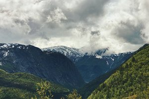 White clouds cover gorgeous fjords