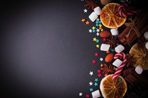 New Year or Christmas background with orange slices of marshmallow space for text, selective focus