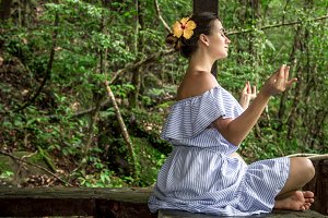 girl in a dress meditates