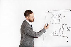 Man writes graph on a white board
