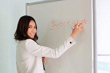 Businesswoman writing success