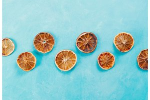 Dried orange slices on blue concrete background