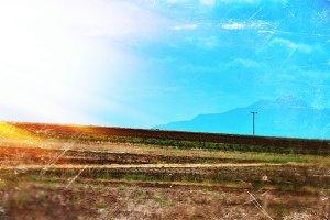 Horizontal vintage landscape postcard with light leak background