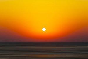 Horizontal vivid orange sunset ocean horizon abstraction blur ba