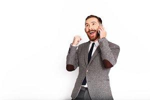 Happy man talks on the phone
