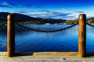 Horizontal vivid Norway fjord ocean landscape pier composition b