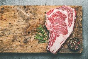 Raw uncooked beef steak rib-eye