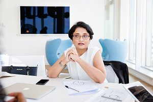 Woman speaking in bright office