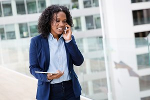 Woman walking to meeting on phone