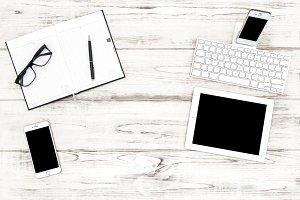 Office desk flat lay tablet pc