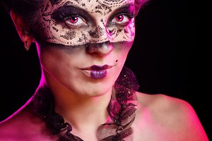 Girl in masquerade mask