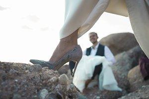 Close up bride shoe on rock