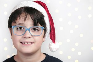 happy boy with glasses at christmas