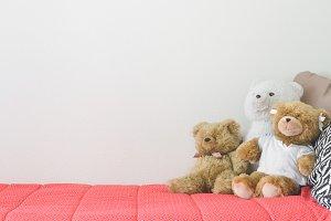 Teddy bears on bed.