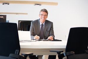 Financial Advisor Sitting At His Desk