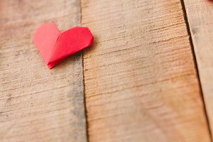 Origami heart on wooden