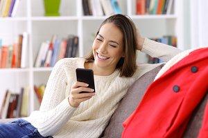 Happy girl checking smart phone