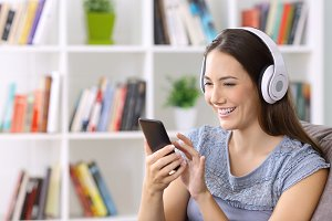 Happy female listening to music