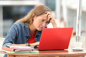 Worried student searching on line